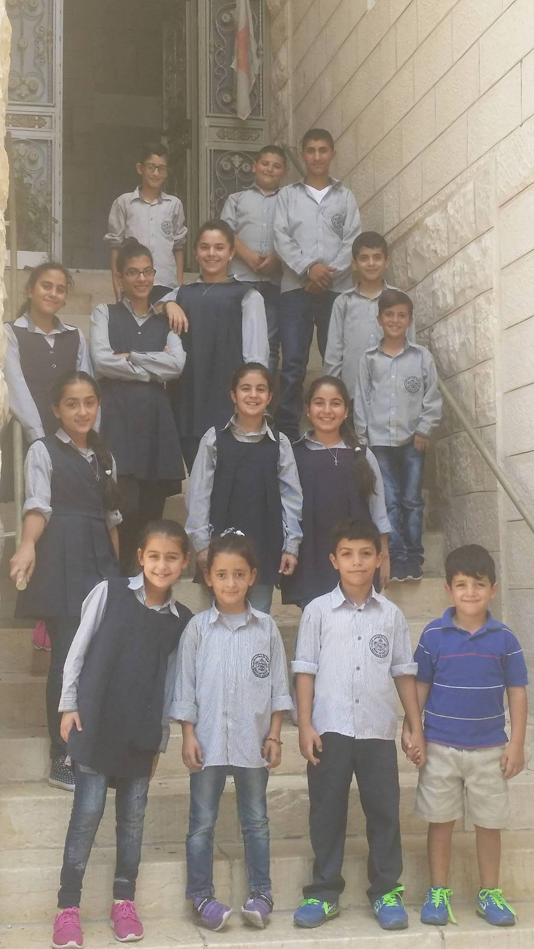 Kids of Taybeh receiving education fund.